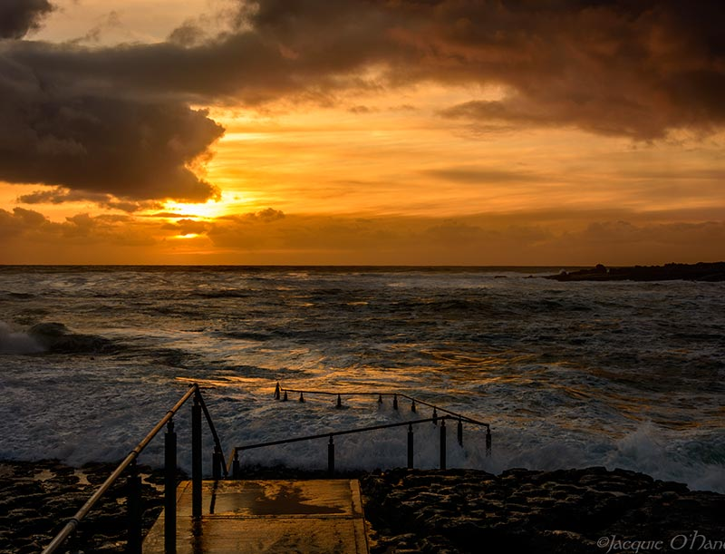 Take your camera or simply sit and watch the sunset down at the pier